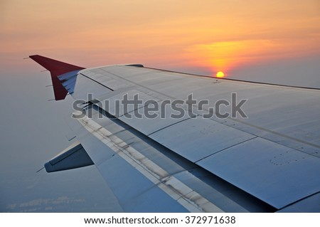View of Sunrise on airplane window - stock photo