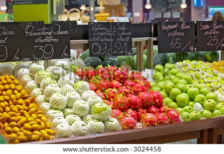 view of supermarket showcase full of nice tropical fruits