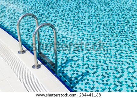 view of Swimming pool stairs from above - stock photo