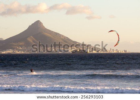 View of table mountain from Dolphin Beach with windsurfer having fun