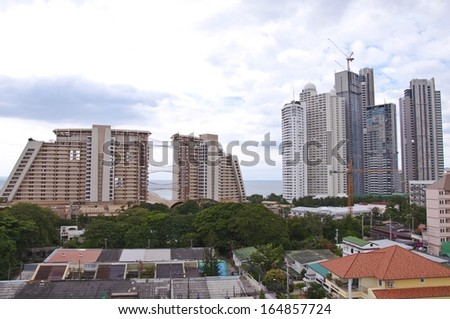 View of tall building on cloudy sky background