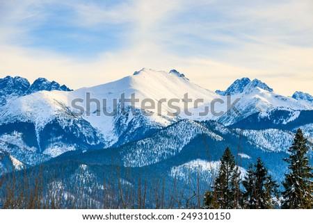 View of Tatra Mountains covered with snow near Bukowina Tatrzankska, Poland - stock photo