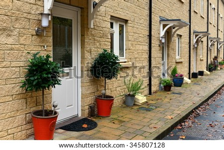 View of Terraced Town Houses on a Typical English Street - stock photo