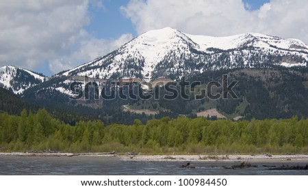 View of Teton Mountain range from a float trip on the Snake River - stock photo