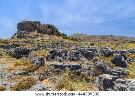 view of the Acropolis of Lindos from rocks below. Rhodes Greece - stock photo