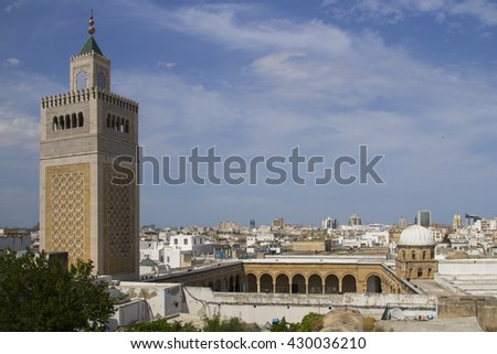View of the Al-Zaytouna Mosque and the skyline of Tunis. The mosque is a landmark of Tunis - stock photo