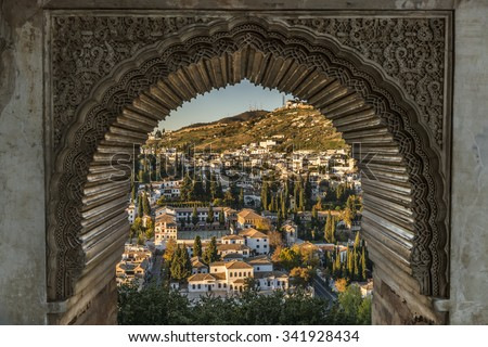 View of the Albayzin district of Granada, Spain, from a window in the Alhambra palace near sunset. - stock photo