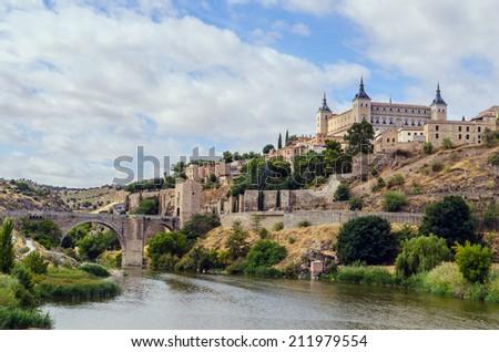 View of the Alcazar as seen near the Alcantara bridge. Toledo. Spain - stock photo