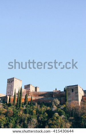 View of the Alhambra against the blue sky in Granada (Spain) - stock photo