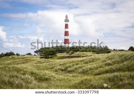 view of the Ameland Lighthouse, known as Bornrif, is a lighthouse on the Dutch island Ameland, one of the Frisian Islands, on the edge of the North Sea, The Netherlands - stock photo
