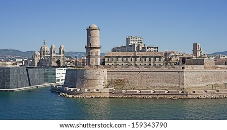"""View of the ancient castle """"Saint Jean"""" and the cathedral """"La Major"""" of Marseille in South France - stock photo"""
