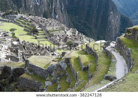 View of the ancient Inca City of Machu Picchu. The 15-th century Inca site.'Lost city of the Incas'. Ruins of the Machu Picchu sanctuary. UNESCO World Heritage site - stock photo
