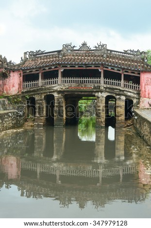 View of the ancient Japanese bridge (Chua Cau) in Hoi An town, Vietnam. Hoi An is a city of Vietnam, on the coast of the East Sea. - stock photo
