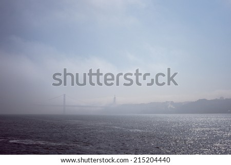 view of The 25 April bridge at the fog (Lisbon)
