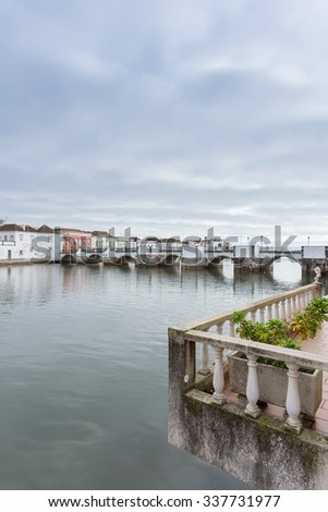 View of the Arab Bridge in Tavira. Portugal Algarve.