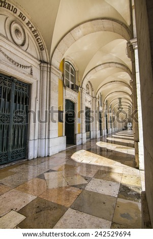 View of the arcades of the Commerce Plaza located in Lisbon, Portugal. - stock photo