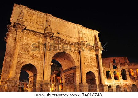 view of the Arch of Constantine and the Coliseum at night in Rome, Italy - stock photo