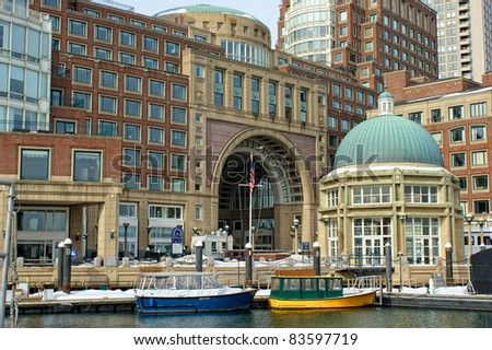 View of the arched entrance to  Historic Rowe's Wharf from inside the wharf in the south end of Boston Massachusetts in winter. - stock photo