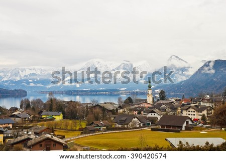 View of the austrian village St. Gilgen, Wolfgangsee lake and alpine mountains - stock photo