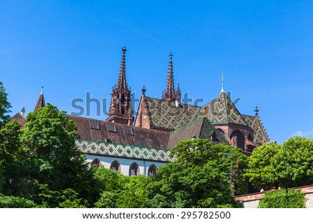 View of the Basel Minster Basel Minster (Basler Munster) cathedral from the boad on Rhine river, Basel, Switzerland - stock photo
