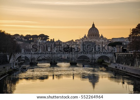 view of the basilica of Saint Peter from the bridge at sunset