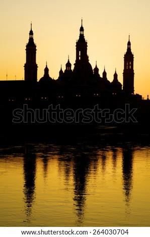 View of the  basilica of the Virgen del Pilar and Ebro river, right is located the medieval bridge known as the Stone Bridge, Zaragoza, Aragon, Spain - stock photo