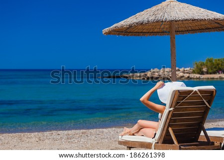 view of the beach with chairs and umbrellas. Greece - stock photo