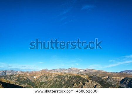View of the Beartooth Mountains in Montana with sky in the top two thirds of the picture - stock photo
