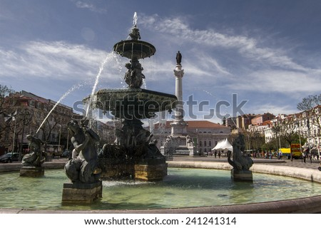 View of the beautiful center fountain in the Rossio square located in Lisbon, Portugal. - stock photo