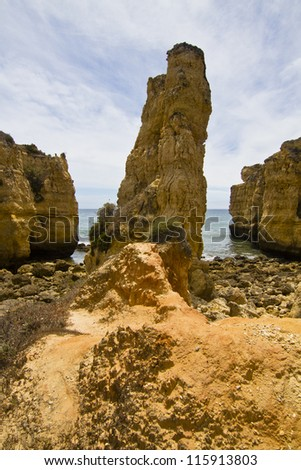 View of the beautiful coastline near Olhos D'Agua in the Algarve, Portugal.