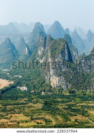 View of the beautiful mountains from the hill in the town of Hingping - China - stock photo