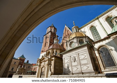 View of the beautiful Saint Stanislas Cathedral at Wawel castle, Krakow, Poland, viewed from behind a gothic arch