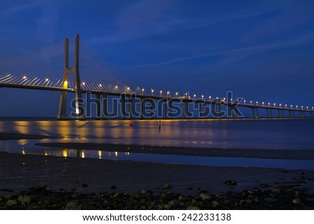 View of the beautiful Vasco da Gama bridge at dawn located on Lisbon, Portugal. - stock photo
