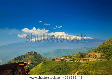 view of the beautiful volcano Etna from the town Castelmola, Sicily, Italy - stock photo