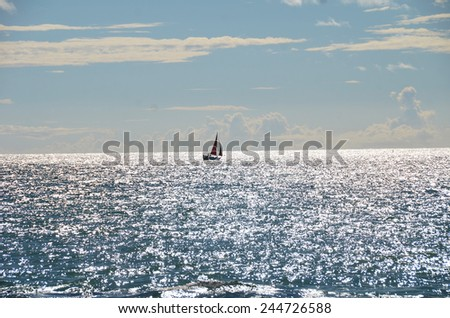 View of the boat walking on the sea, backlit. Sochi, Russia - stock photo