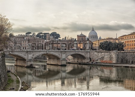View of the bridge of Ponte Vittorio Emanuele II and saint Peters basilica over the river tiber. Rome, Italy. - stock photo