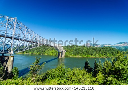 View of the Bridge of the Gods as seen from Oregon crossing the Columbia River into Washington - stock photo
