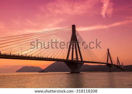 View of the bridge Rio-Antirio in Greece, at sunset. - stock photo