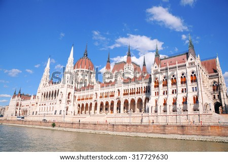 View of the building of the Hungarian parliament in budapest taken from a boat in the danube river - stock photo