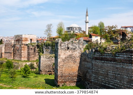 View of the Byzantine city walls of Istanbul (Theodosius wall) after a partial restoration, near the Golden Horn - stock photo