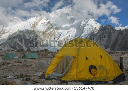 View of the camp of climbers on Khumbu glacier near near Gorak Shep village with Everest in the background - Nepal, Himalayas - stock photo