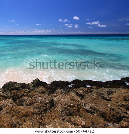 View of the Caribbean from the rocky coast of Barbados - stock photo