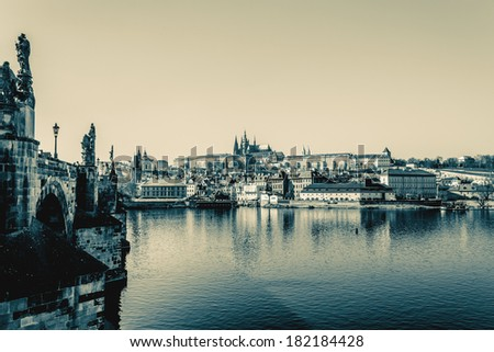 View of the castle and the Vltava River in retro colors, Prague, Czech Republic.