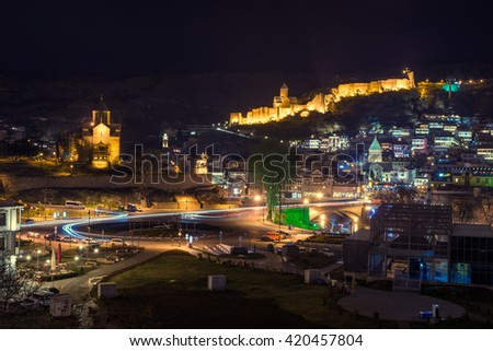 view of the castle at night in Tbilisi