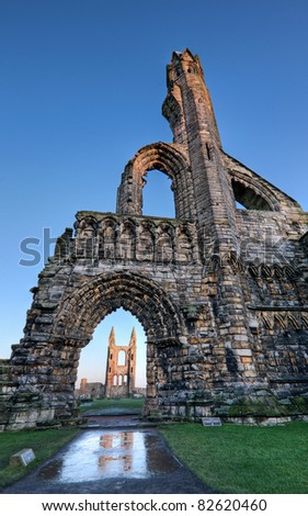 View of the cathedral in St Andrews, Fife, looking towards the east gable, framed by the arch in the west gate.