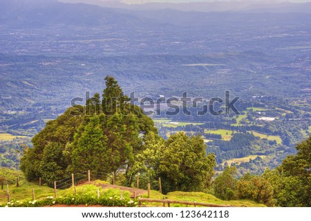 View of the central valley from an observation area on the Poas Volcano in Costa Rica. - stock photo