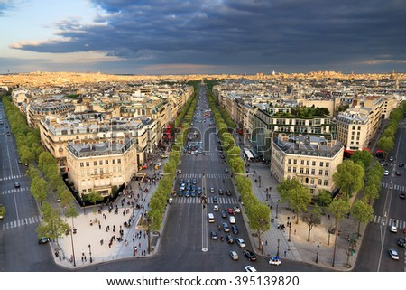 View of the Champs-Elysees seen from the Arc de Triomphe in the afternoon in Paris, France - stock photo