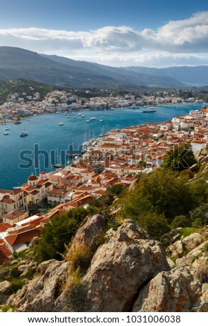 View of the Chora village of Poros island and Galatas village in Peloponnese from a nearby hill, Greece.