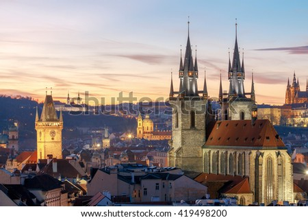 View of the Church of Our Lady before Tyn and St. Vitus Cathedral at sunset. - stock photo