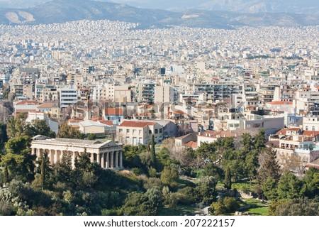 View of the city of Athens as seen from Areopagus or Mars Hill with the temple of Hephaistos (also known as Thissio or Theseion) on the foreground and mountains on the background, Greece.